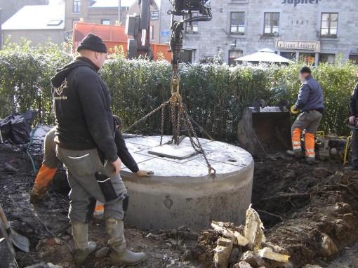 > Enfouissement d'une fosse septique.